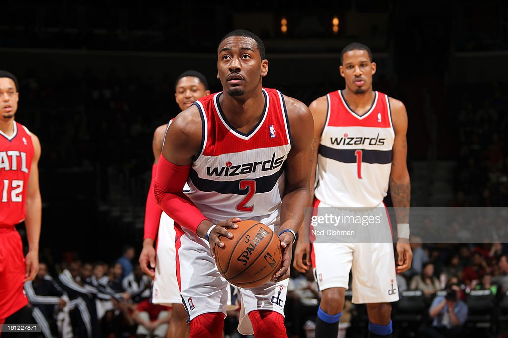 <a gi-track='captionPersonalityLinkClicked' href=/galleries/search?phrase=John+Wall&family=editorial&specificpeople=2265812 ng-click='$event.stopPropagation()'>John Wall</a> #2 of the Washington Wizards shoots a foul shot against the Atlanta Hawks during the game at the Verizon Center on January 12, 2013 in Washington, DC.