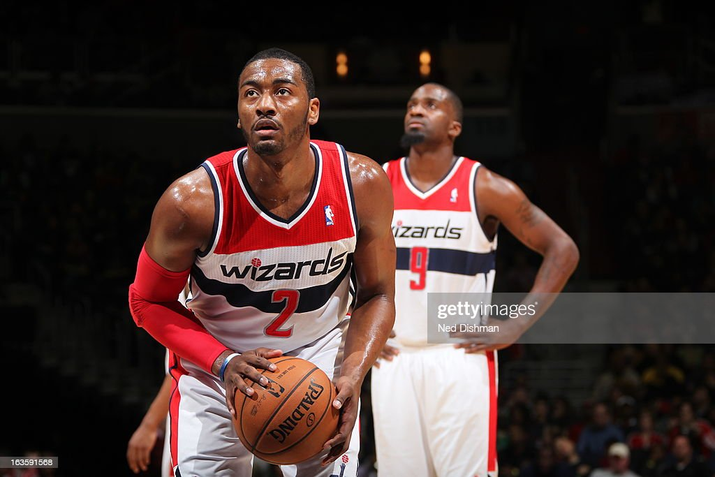 <a gi-track='captionPersonalityLinkClicked' href=/galleries/search?phrase=John+Wall&family=editorial&specificpeople=2265812 ng-click='$event.stopPropagation()'>John Wall</a> #2 of the Washington Wizards shoots a foul shot against the Houston Rockets during the game at the Verizon Center on February 23, 2013 in Washington, DC.
