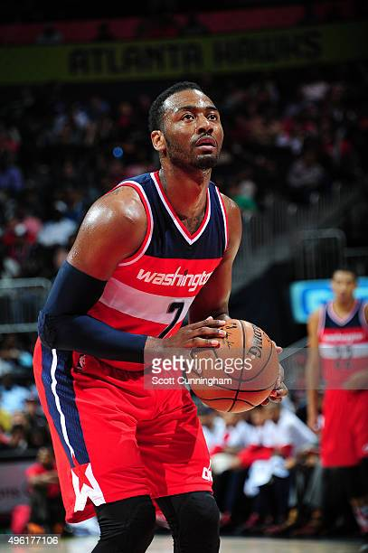 John Wall of the Washington Wizards shoots a free throw against the Atlanta Hawks during the game on November 7 2015 at Philips Arena in Atlanta...