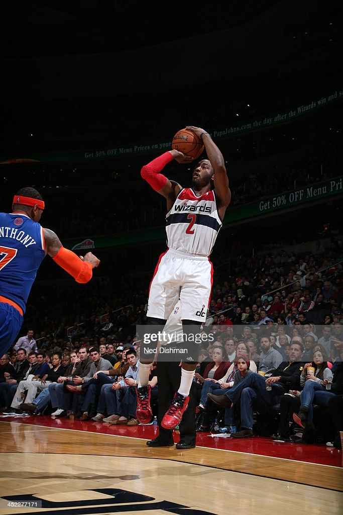 <a gi-track='captionPersonalityLinkClicked' href=/galleries/search?phrase=John+Wall&family=editorial&specificpeople=2265812 ng-click='$event.stopPropagation()'>John Wall</a> #2 of the Washington Wizards shoots a three pointer against the New York Knicks during the game at the Verizon Center on November 23, 2013 in Washington, DC.
