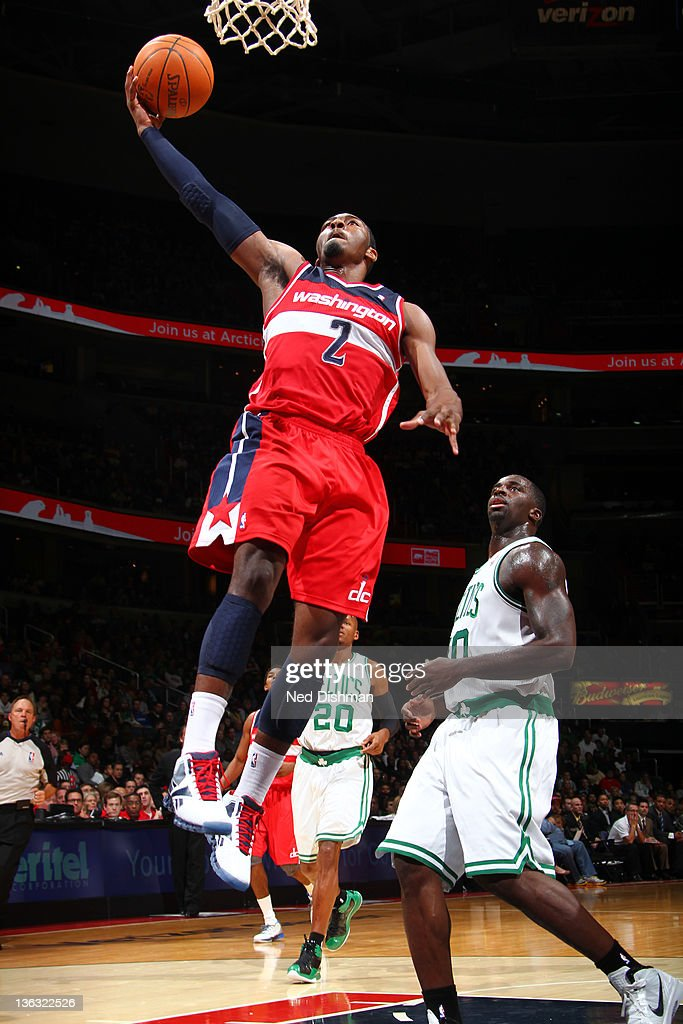 <a gi-track='captionPersonalityLinkClicked' href=/galleries/search?phrase=John+Wall&family=editorial&specificpeople=2265812 ng-click='$event.stopPropagation()'>John Wall</a> #2 of the Washington Wizards shoots against <a gi-track='captionPersonalityLinkClicked' href=/galleries/search?phrase=Brandon+Bass&family=editorial&specificpeople=233806 ng-click='$event.stopPropagation()'>Brandon Bass</a> #30 of the Boston Celtics during the game at the Verizon Center on January 1, 2012 in Washington, DC.