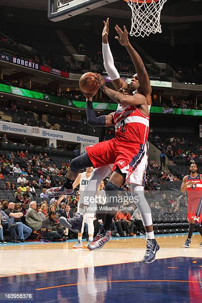 John Wall of the Washington Wizards shoots against Brendan Haywood of the Charlotte Bobcats at the Time Warner Cable Arena on March 18 2013 in...