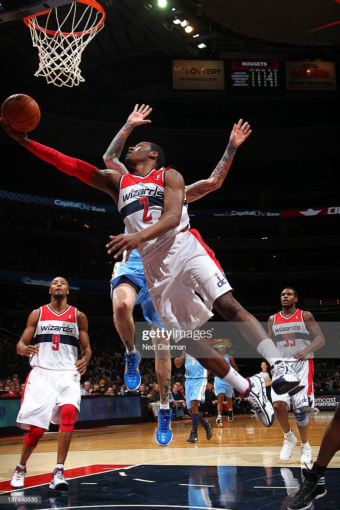 <a gi-track='captionPersonalityLinkClicked' href=/galleries/search?phrase=John+Wall&family=editorial&specificpeople=2265812 ng-click='$event.stopPropagation()'>John Wall</a> #2 of the Washington Wizards shoots against <a gi-track='captionPersonalityLinkClicked' href=/galleries/search?phrase=Chris+Andersen+-+Basketball+Player&family=editorial&specificpeople=12319595 ng-click='$event.stopPropagation()'>Chris Andersen</a> #11 of the Denver Nuggets during the game at the Verizon Center on January 20, 2012 in Washington, DC.
