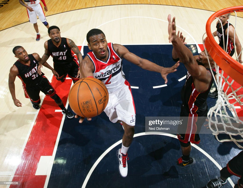 <a gi-track='captionPersonalityLinkClicked' href=/galleries/search?phrase=John+Wall&family=editorial&specificpeople=2265812 ng-click='$event.stopPropagation()'>John Wall</a> #2 of the Washington Wizards shoots against <a gi-track='captionPersonalityLinkClicked' href=/galleries/search?phrase=Chris+Bosh&family=editorial&specificpeople=201574 ng-click='$event.stopPropagation()'>Chris Bosh</a> #1 of the Miami Heat during the game at the Verizon Center on February 10, 2012 in Washington, DC.