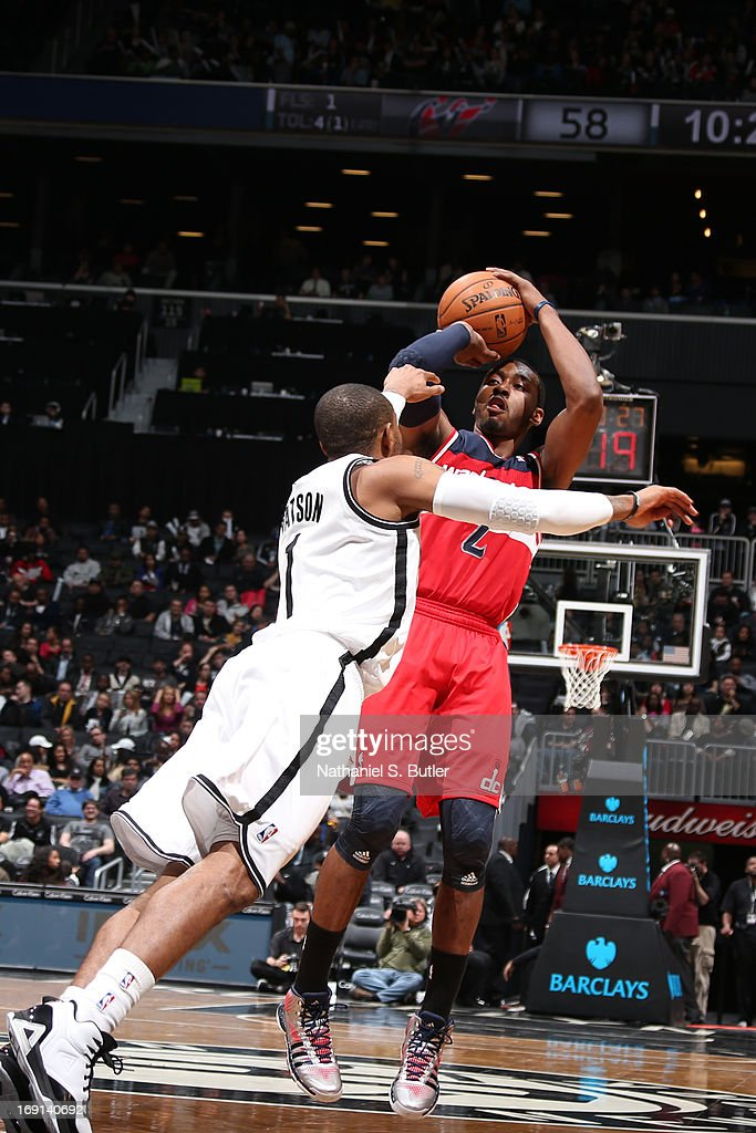 John Wall #2 of the Washington Wizards shoots against C.J. Watson #1 of the Brooklyn Nets on April 15, 2013 at the Barclays Center in the Brooklyn borough of New York City.
