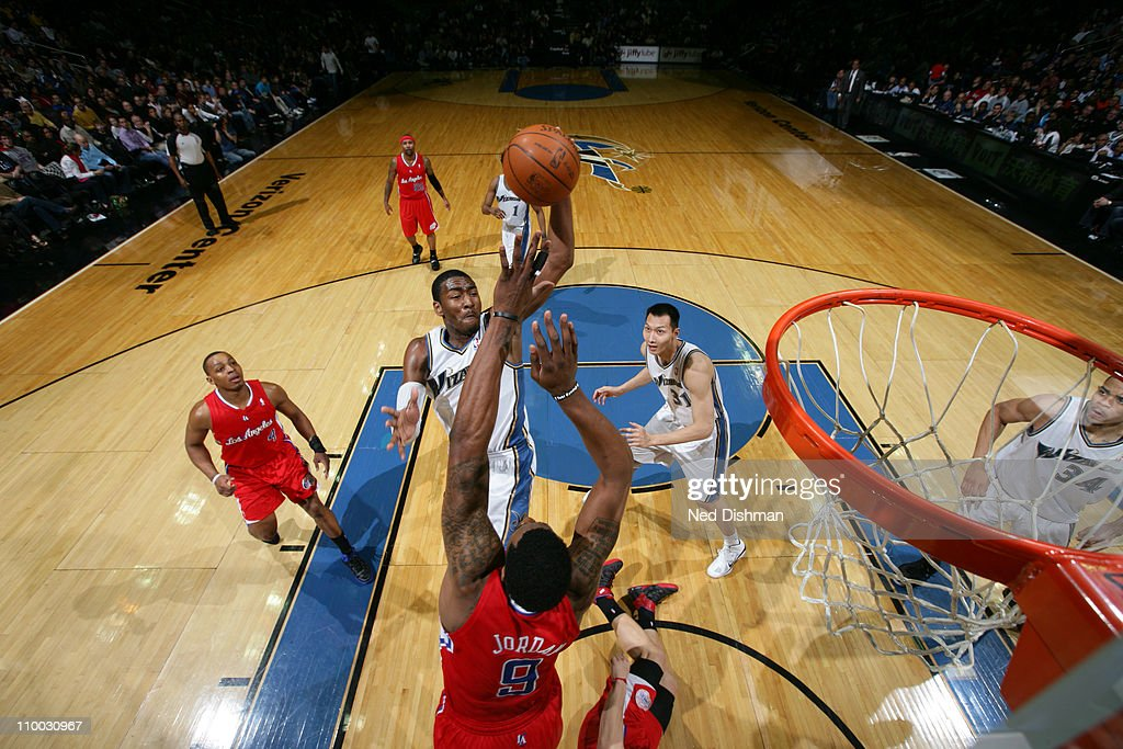 <a gi-track='captionPersonalityLinkClicked' href=/galleries/search?phrase=John+Wall&family=editorial&specificpeople=2265812 ng-click='$event.stopPropagation()'>John Wall</a> #2 of the Washington Wizards shoots against <a gi-track='captionPersonalityLinkClicked' href=/galleries/search?phrase=DeAndre+Jordan&family=editorial&specificpeople=4665718 ng-click='$event.stopPropagation()'>DeAndre Jordan</a> #9 of the Los Angeles Clippers at the Verizon Center on March 12, 2011 in Washington, DC.