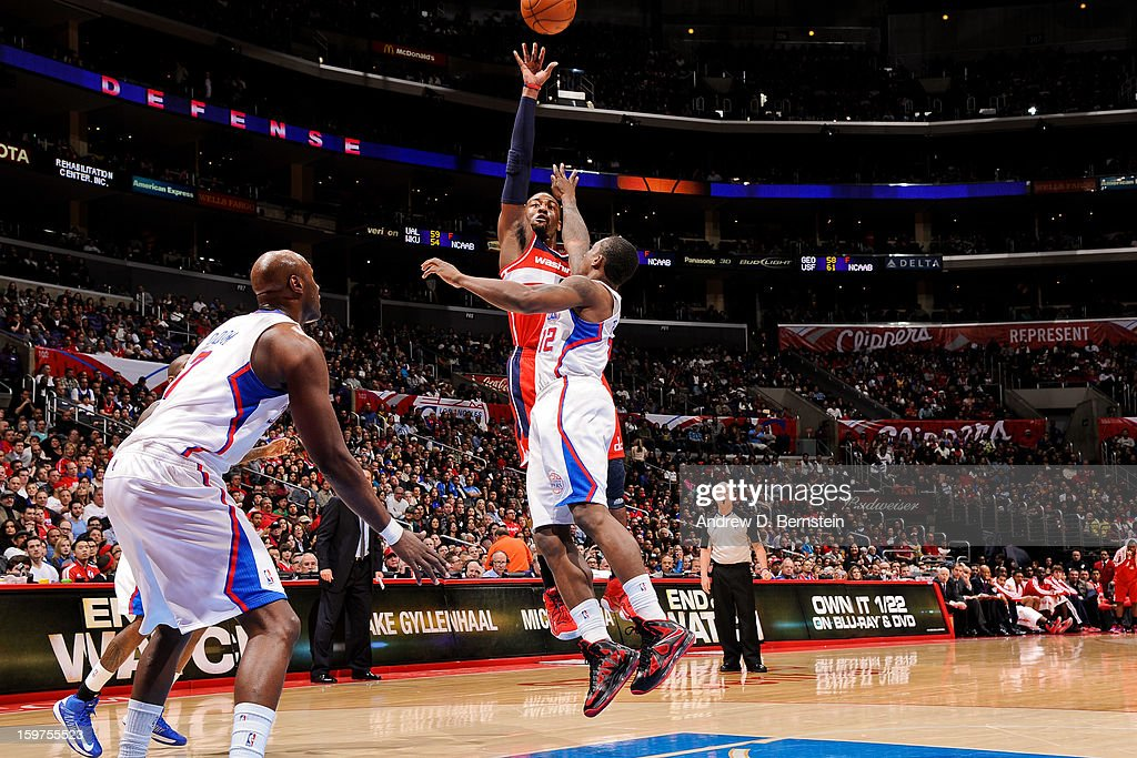 John Wall #2 of the Washington Wizards shoots against Eric Bledsoe #12 of the Los Angeles Clippers at Staples Center on January 19, 2013 in Los Angeles, California.