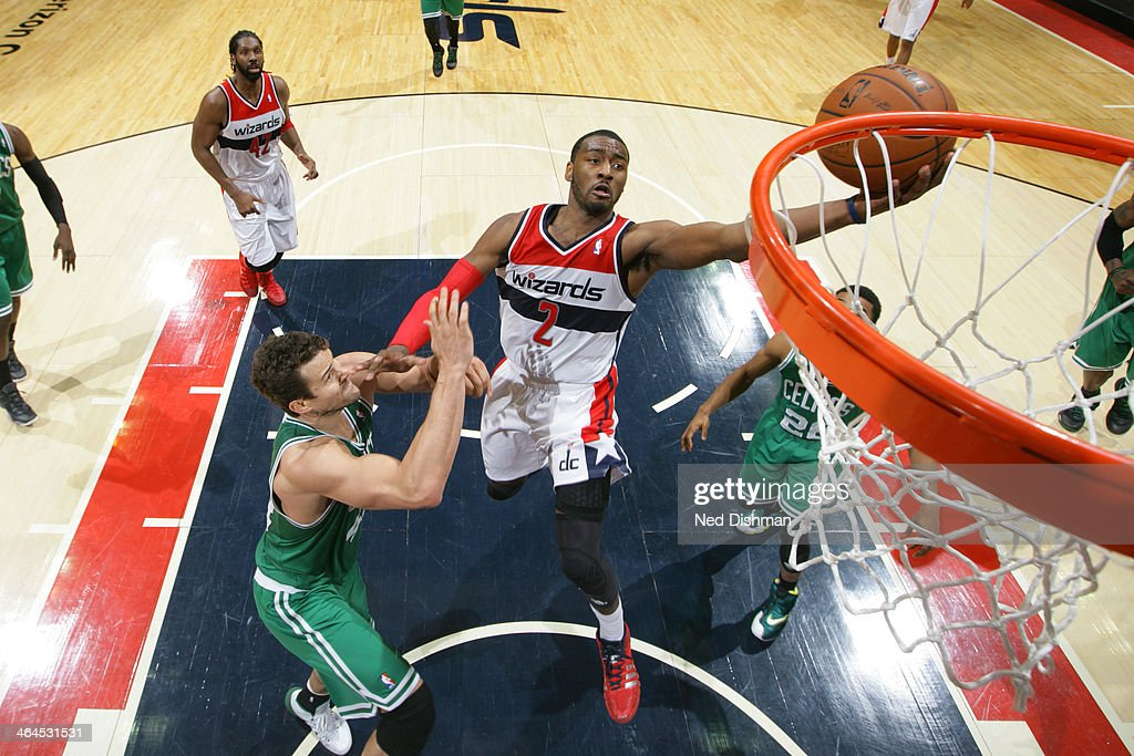 <a gi-track='captionPersonalityLinkClicked' href=/galleries/search?phrase=John+Wall&family=editorial&specificpeople=2265812 ng-click='$event.stopPropagation()'>John Wall</a> #2 of the Washington Wizards shoots against Kris Humpries #43 of the Boston Celtics during the game at the Verizon Center on January 22, 2014 in Washington, DC.