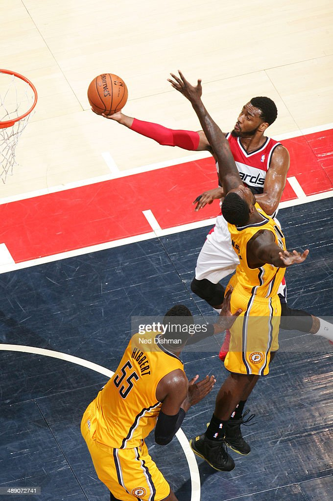 <a gi-track='captionPersonalityLinkClicked' href=/galleries/search?phrase=John+Wall&family=editorial&specificpeople=2265812 ng-click='$event.stopPropagation()'>John Wall</a> #2 of the Washington Wizards shoots against <a gi-track='captionPersonalityLinkClicked' href=/galleries/search?phrase=Lance+Stephenson&family=editorial&specificpeople=5298304 ng-click='$event.stopPropagation()'>Lance Stephenson</a> #1 of the Indiana Pacers in Game Three of the Eastern Conference Semifinals during the 2014 NBA Playoffs at the Verizon Center on May 9, 2014 in Washington, DC.