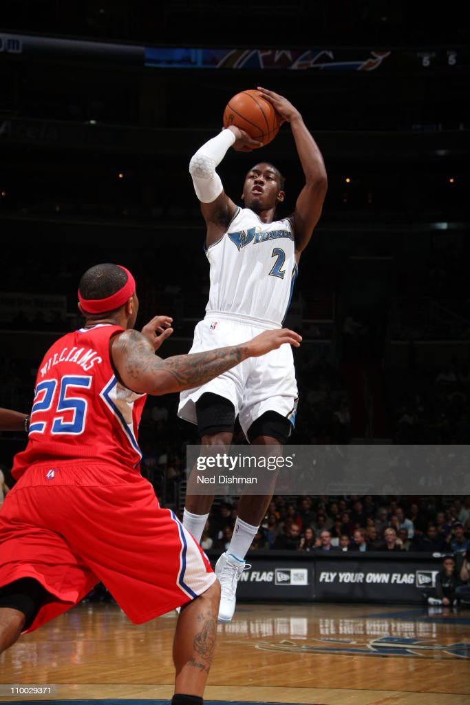 <a gi-track='captionPersonalityLinkClicked' href=/galleries/search?phrase=John+Wall&family=editorial&specificpeople=2265812 ng-click='$event.stopPropagation()'>John Wall</a> #2 of the Washington Wizards shoots against Mo Williams #25 of the Los Angeles Clippers at the Verizon Center on March 12, 2011 in Washington, DC.