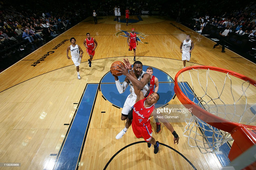 <a gi-track='captionPersonalityLinkClicked' href=/galleries/search?phrase=John+Wall&family=editorial&specificpeople=2265812 ng-click='$event.stopPropagation()'>John Wall</a> #2 of the Washington Wizards shoots against <a gi-track='captionPersonalityLinkClicked' href=/galleries/search?phrase=Randy+Foye&family=editorial&specificpeople=240185 ng-click='$event.stopPropagation()'>Randy Foye</a> #4 of the Los Angeles Clippers at the Verizon Center on March 12, 2011 in Washington, DC.