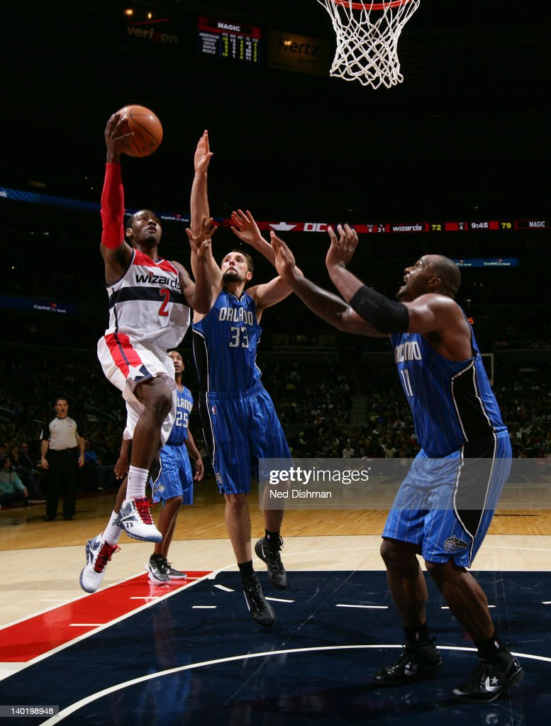 <a gi-track='captionPersonalityLinkClicked' href=/galleries/search?phrase=John+Wall&family=editorial&specificpeople=2265812 ng-click='$event.stopPropagation()'>John Wall</a> #2 of the Washington Wizards shoots against Ryan Anderson #33 and <a gi-track='captionPersonalityLinkClicked' href=/galleries/search?phrase=Glen+Davis+-+Basketball+Player&family=editorial&specificpeople=709385 ng-click='$event.stopPropagation()'>Glen Davis</a> #11 of the Orlando Magic during the game at the Verizon Center on February 29, 2012 in Washington, DC.