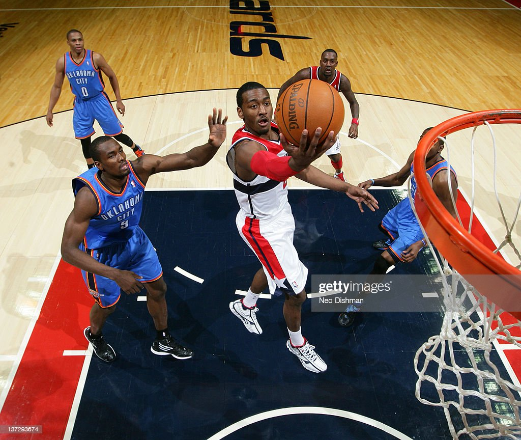 <a gi-track='captionPersonalityLinkClicked' href=/galleries/search?phrase=John+Wall&family=editorial&specificpeople=2265812 ng-click='$event.stopPropagation()'>John Wall</a> #2 of the Washington Wizards shoots against <a gi-track='captionPersonalityLinkClicked' href=/galleries/search?phrase=Serge+Ibaka&family=editorial&specificpeople=5133378 ng-click='$event.stopPropagation()'>Serge Ibaka</a> #9 of the Oklahoma City Thunder during the game at the Verizon Center on January 18, 2012 in Washington, DC.