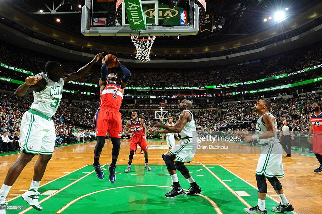 John Wall #2 of the Washington Wizards shoots against the Boston Celtics on April 16, 2014 at the TD Garden in Boston, Massachusetts.