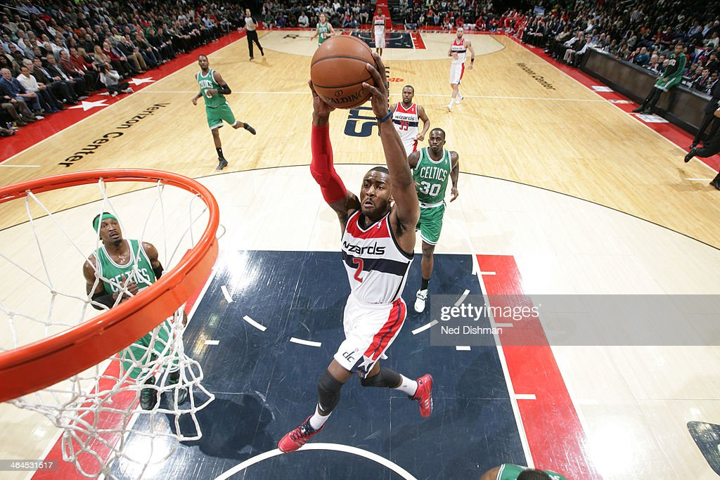 John Wall #2 of the Washington Wizards shoots against the Boston Celtics during the game at the Verizon Center on January 22, 2014 in Washington, DC.