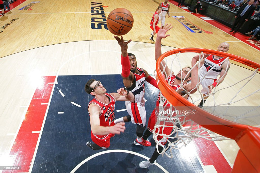 <a gi-track='captionPersonalityLinkClicked' href=/galleries/search?phrase=John+Wall&family=editorial&specificpeople=2265812 ng-click='$event.stopPropagation()'>John Wall</a> #2 of the Washington Wizards shoots against the Chicago Bulls in Game Three of the Eastern Conference Quarterfinals during the 2014 NBA Playoffs at the Verizon Center on April 25, 2014 in Washington, DC.