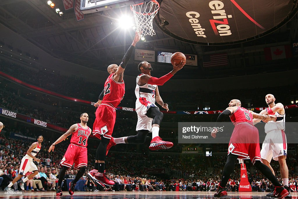 <a gi-track='captionPersonalityLinkClicked' href=/galleries/search?phrase=John+Wall&family=editorial&specificpeople=2265812 ng-click='$event.stopPropagation()'>John Wall</a> #2 of the Washington Wizards shoots against the Chicago Bulls in Game Four of the Eastern Conference Quarterfinals during the 2014 NBA Playoffs at the Verizon Center on April 27, 2014 in Washington, DC.