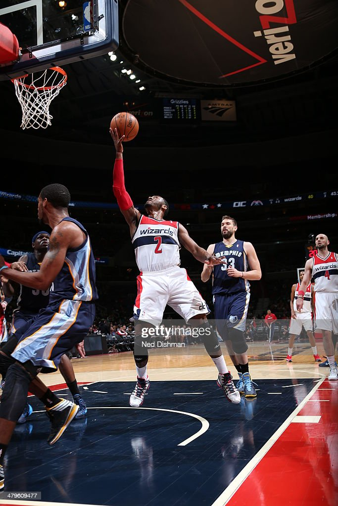 <a gi-track='captionPersonalityLinkClicked' href=/galleries/search?phrase=John+Wall&family=editorial&specificpeople=2265812 ng-click='$event.stopPropagation()'>John Wall</a> #2 of the Washington Wizards shoots against the Memphis Grizzlies at the Verizon Center on March 3, 2014 in Washington, DC.
