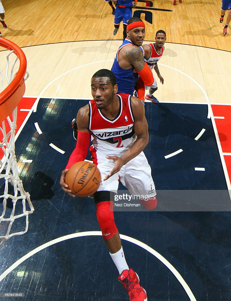 John Wall #2 of the Washington Wizards shoots against the New York Knicks during the game at the Verizon Center on March 1, 2013 in Washington, DC.