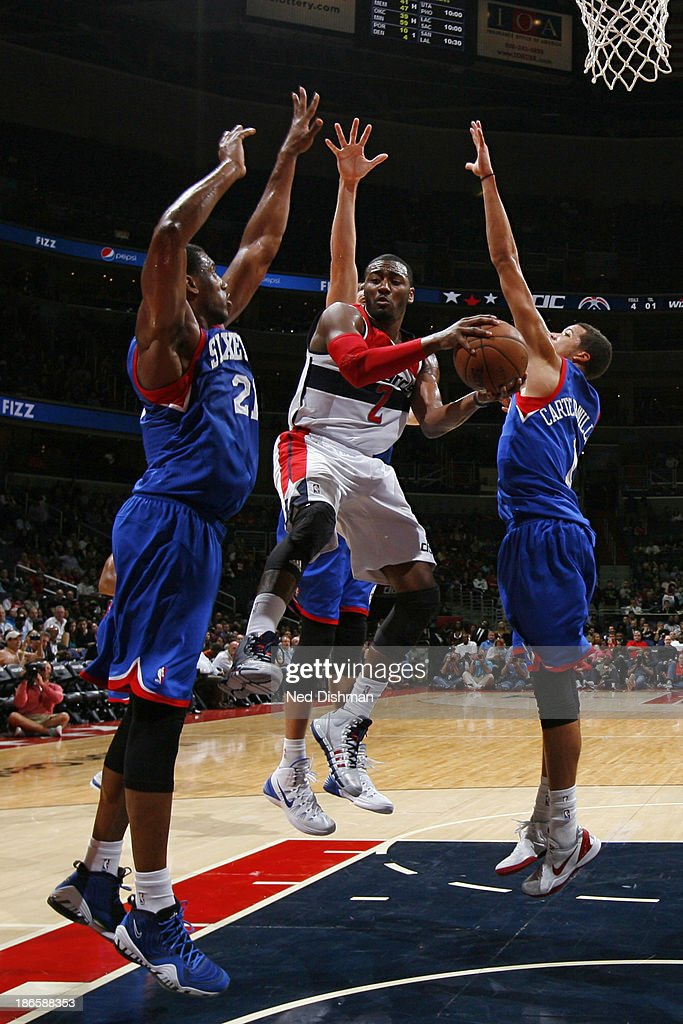 <a gi-track='captionPersonalityLinkClicked' href=/galleries/search?phrase=John+Wall&family=editorial&specificpeople=2265812 ng-click='$event.stopPropagation()'>John Wall</a> #2 of the Washington Wizards shoots against the Philadelphia 76ers during the game at the Verizon Center on November 1, 2013 in Washington, DC.