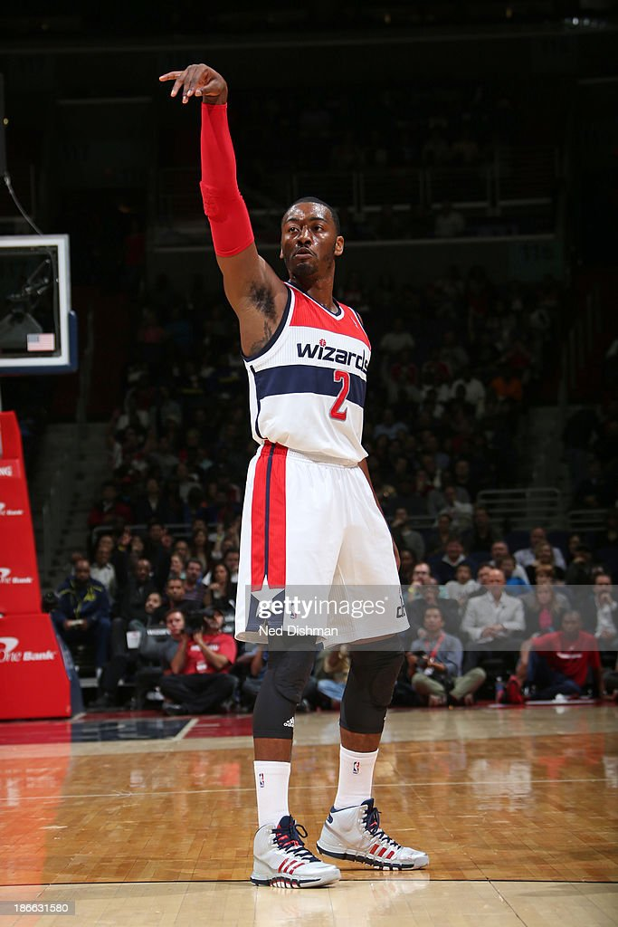 <a gi-track='captionPersonalityLinkClicked' href=/galleries/search?phrase=John+Wall&family=editorial&specificpeople=2265812 ng-click='$event.stopPropagation()'>John Wall</a> #2 of the Washington Wizards shoots against the Philadelphia 76ers during the pre-season game at the Verizon Center on November 1, 2013 in Washington, DC.