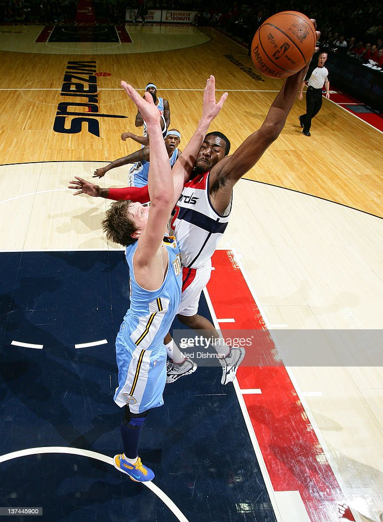 <a gi-track='captionPersonalityLinkClicked' href=/galleries/search?phrase=John+Wall&family=editorial&specificpeople=2265812 ng-click='$event.stopPropagation()'>John Wall</a> #2 of the Washington Wizards shoots against <a gi-track='captionPersonalityLinkClicked' href=/galleries/search?phrase=Timofey+Mozgov&family=editorial&specificpeople=3949705 ng-click='$event.stopPropagation()'>Timofey Mozgov</a> #25 of the Denver Nuggets during the game at the Verizon Center on January 20, 2012 in Washington, DC.
