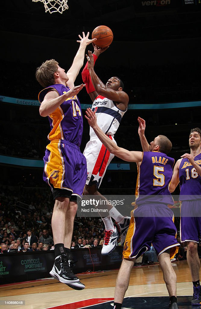 <a gi-track='captionPersonalityLinkClicked' href=/galleries/search?phrase=John+Wall&family=editorial&specificpeople=2265812 ng-click='$event.stopPropagation()'>John Wall</a> #2 of the Washington Wizards shoots against <a gi-track='captionPersonalityLinkClicked' href=/galleries/search?phrase=Troy+Murphy&family=editorial&specificpeople=201794 ng-click='$event.stopPropagation()'>Troy Murphy</a> #14 of the Los Angeles Lakers during the game at the Verizon Center on March 7, 2012 in Washington, DC.