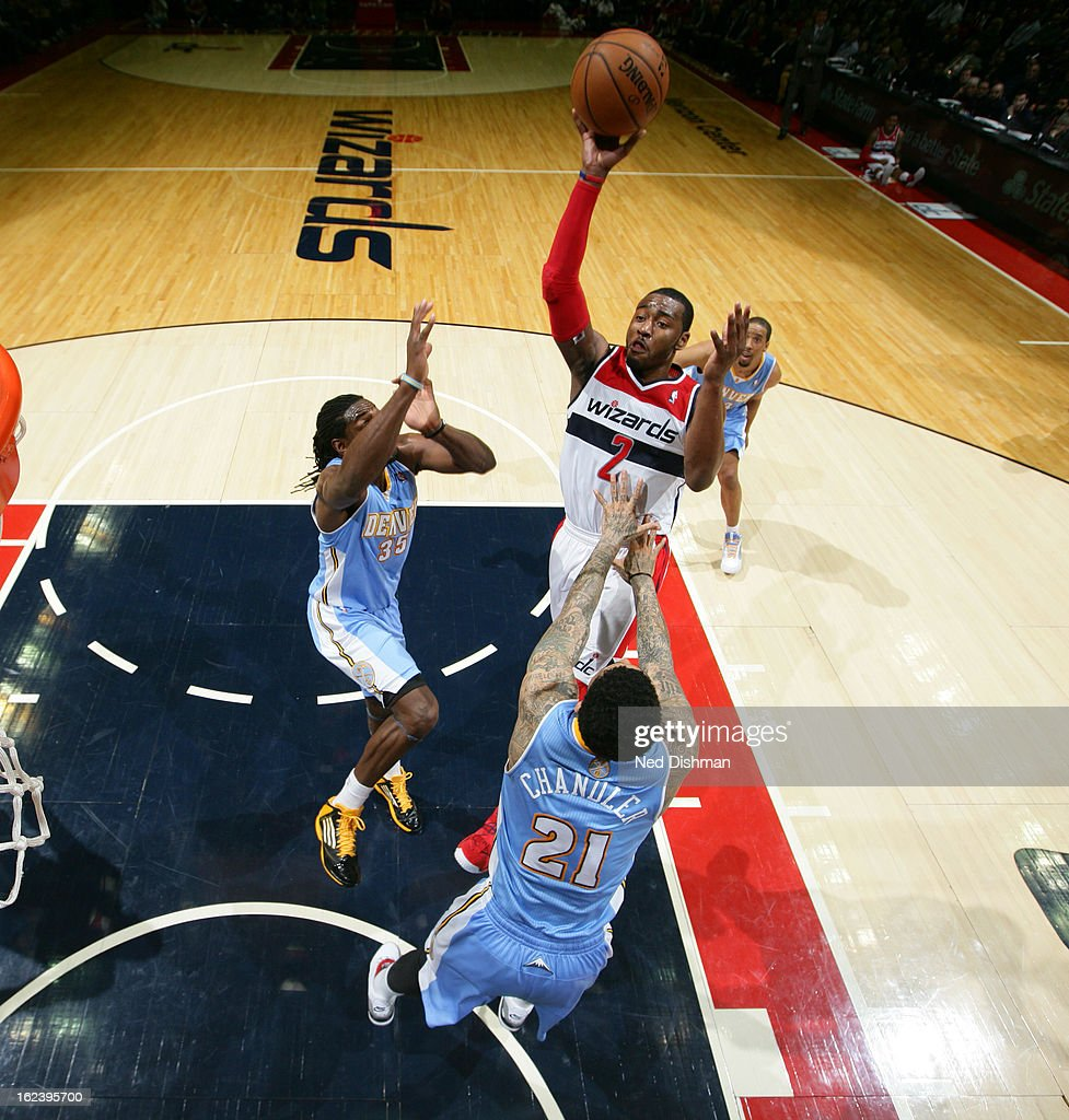 <a gi-track='captionPersonalityLinkClicked' href=/galleries/search?phrase=John+Wall&family=editorial&specificpeople=2265812 ng-click='$event.stopPropagation()'>John Wall</a> #2 of the Washington Wizards shoots against <a gi-track='captionPersonalityLinkClicked' href=/galleries/search?phrase=Wilson+Chandler&family=editorial&specificpeople=809324 ng-click='$event.stopPropagation()'>Wilson Chandler</a> #21 and <a gi-track='captionPersonalityLinkClicked' href=/galleries/search?phrase=Kenneth+Faried&family=editorial&specificpeople=5765135 ng-click='$event.stopPropagation()'>Kenneth Faried</a> #35 of the Denver Nuggets during the game at the Verizon Center on February 22, 2013 in Washington, DC.