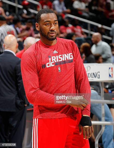 John Wall of the Washington Wizards shoots around as he warms up for Game Five of the Eastern Conference Semifinals of the 2015 NBA Playoffs against...