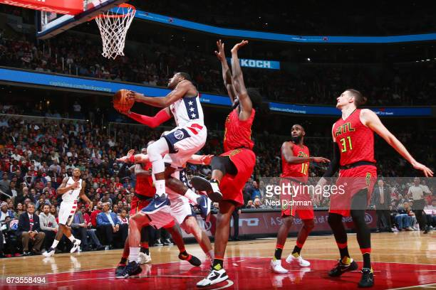 John Wall of the Washington Wizards shoots the ball against the Atlanta Hawks in Game Five of the Eastern Conference Quarterfinals of the 2017 NBA...