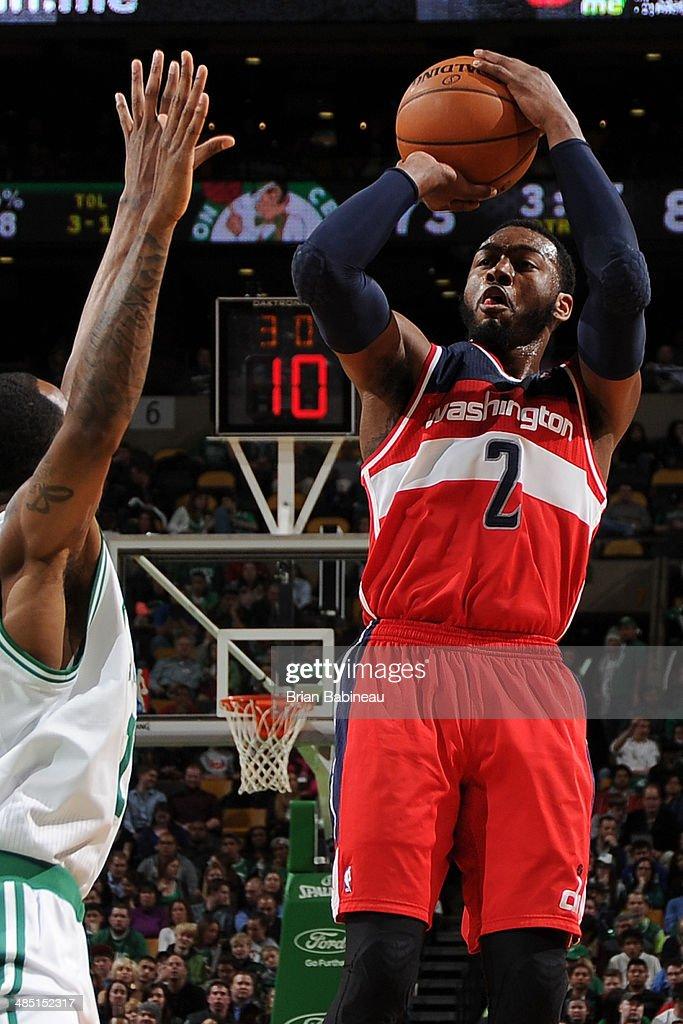 John Wall #2 of the Washington Wizards shoots the ball against the Boston Celtics on April 16, 2014 at the TD Garden in Boston, Massachusetts.