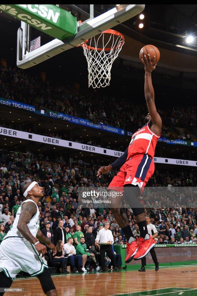 John Wall #2 of the Washington Wizards shoots the ballagainst the Boston Celtics on March 20, 2017 at the TD Garden in Boston, Massachusetts.