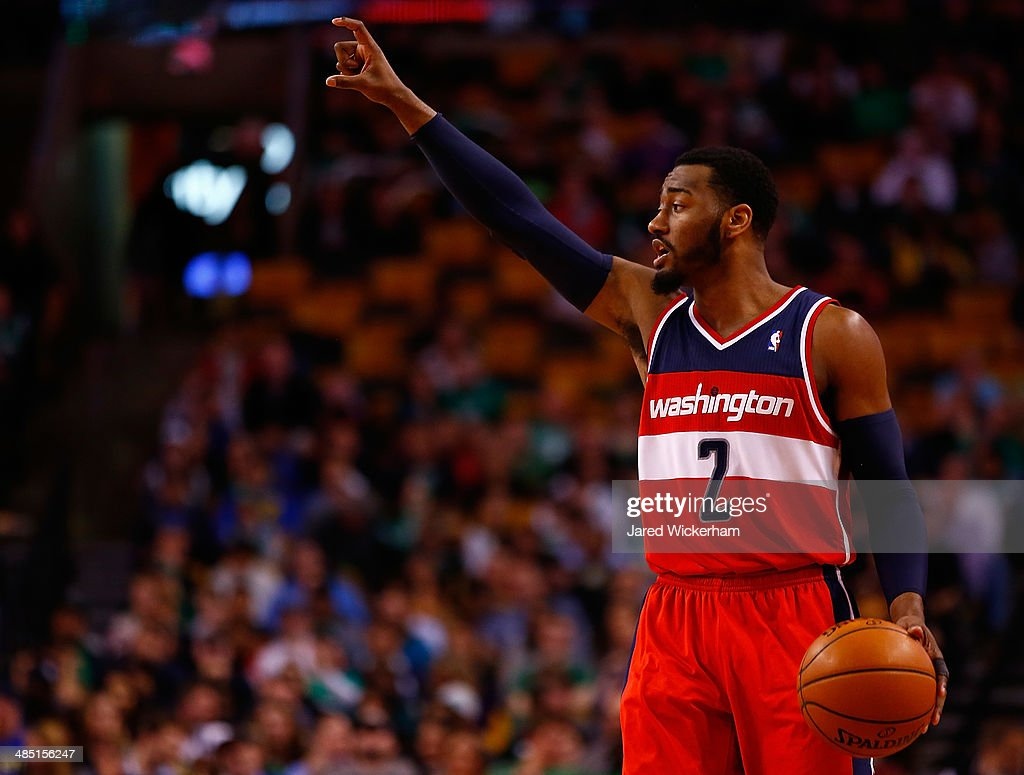 John Wall #2 of the Washington Wizards signals to his teammates against the Boston Celtics in the second half during the game at TD Garden on April 16, 2014 in Boston, Massachusetts.