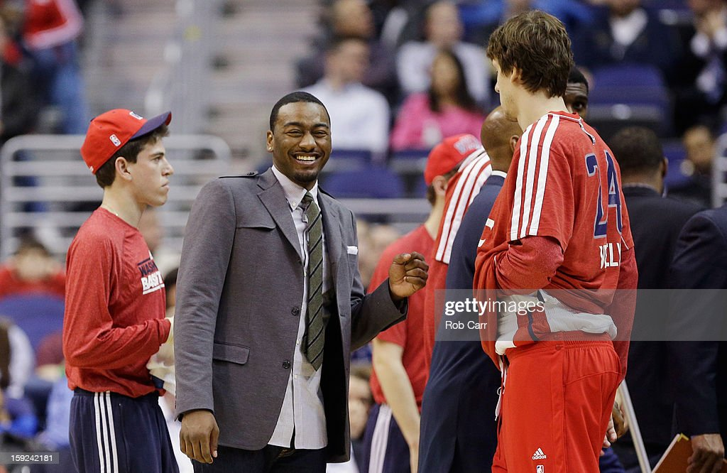 <a gi-track='captionPersonalityLinkClicked' href=/galleries/search?phrase=John+Wall&family=editorial&specificpeople=2265812 ng-click='$event.stopPropagation()'>John Wall</a> #2 (C) of the Washington Wizards smiles during a timeout against the Atlanta Hawks at Verizon Center on December 18, 2012 in Washington, DC.