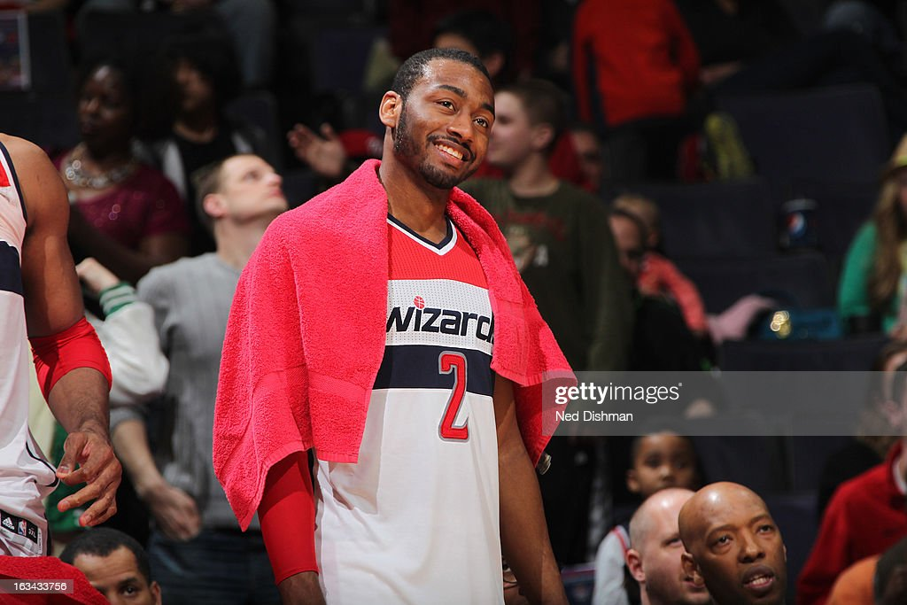 John Wall #2 of the Washington Wizards smiles during the win against the Charlotte Bobcats during the game at the Verizon Center on March 9, 2013 in Washington, DC.