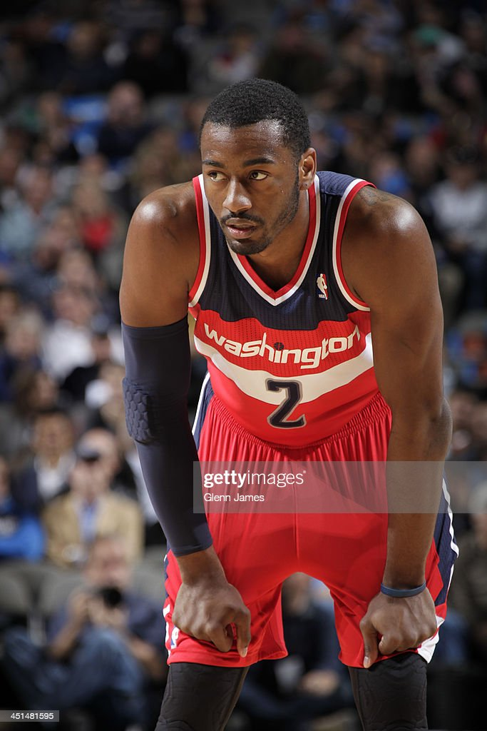 <a gi-track='captionPersonalityLinkClicked' href=/galleries/search?phrase=John+Wall&family=editorial&specificpeople=2265812 ng-click='$event.stopPropagation()'>John Wall</a> #2 of the Washington Wizards stands on the court against the Dallas Mavericks on November 12, 2013 at the American Airlines Center in Dallas, Texas.