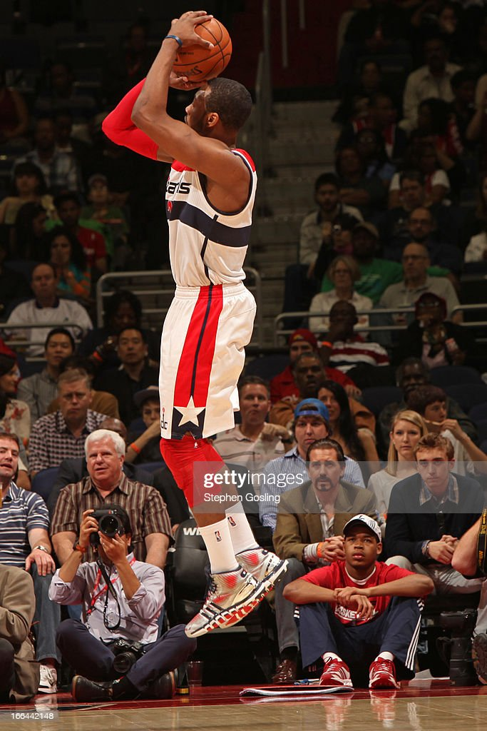 <a gi-track='captionPersonalityLinkClicked' href=/galleries/search?phrase=John+Wall&family=editorial&specificpeople=2265812 ng-click='$event.stopPropagation()'>John Wall</a> #2 of the Washington Wizards takes a shot against the Philadelphia 76ers at the Verizon Center on April 12, 2013 in Washington, DC.