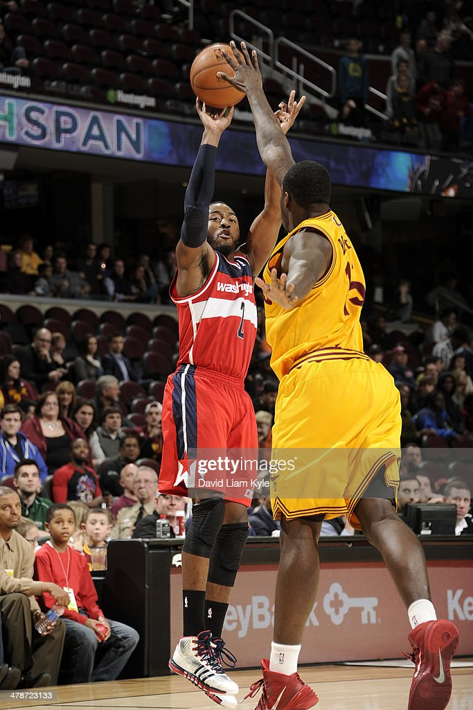<a gi-track='captionPersonalityLinkClicked' href=/galleries/search?phrase=John+Wall&family=editorial&specificpeople=2265812 ng-click='$event.stopPropagation()'>John Wall</a> #2 of the Washington Wizards takes a shot against the Cleveland Cavaliers at The Quicken Loans Arena on February 23, 2014 in Cleveland, Ohio.