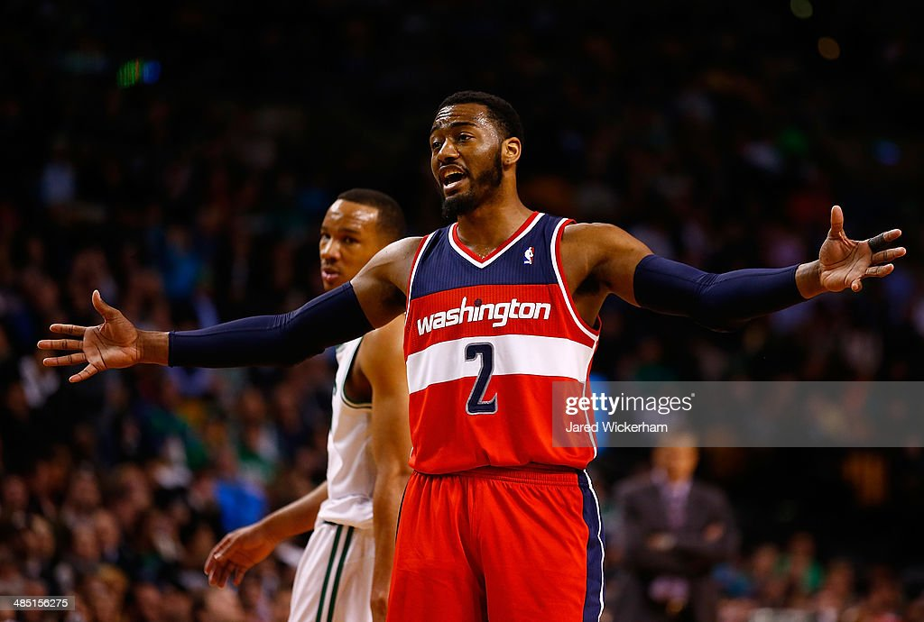 John Wall #2 of the Washington Wizards talks to his teammates against the Boston Celtics in the second half during the game at TD Garden on April 16, 2014 in Boston, Massachusetts.