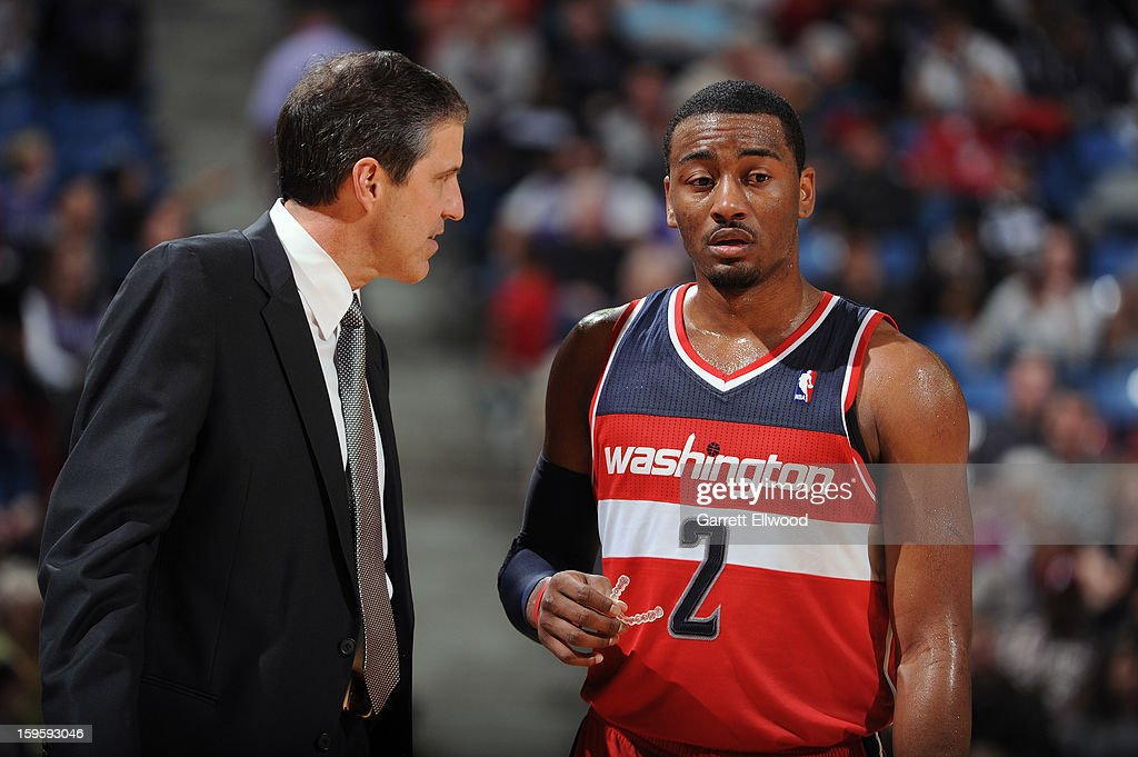 <a gi-track='captionPersonalityLinkClicked' href=/galleries/search?phrase=John+Wall&family=editorial&specificpeople=2265812 ng-click='$event.stopPropagation()'>John Wall</a> #2 of the Washington Wizards talks with head coach Randy Whittman during a break in action against the Sacramento Kings on January 16, 2013 at Sleep Train Arena in Sacramento, California.