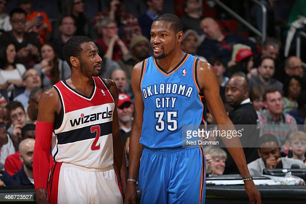 John Wall of the Washington Wizards talks with Kevin Durant of the Oklahoma City Thunder during the game at the Verizon Center on February 2 2014 in...