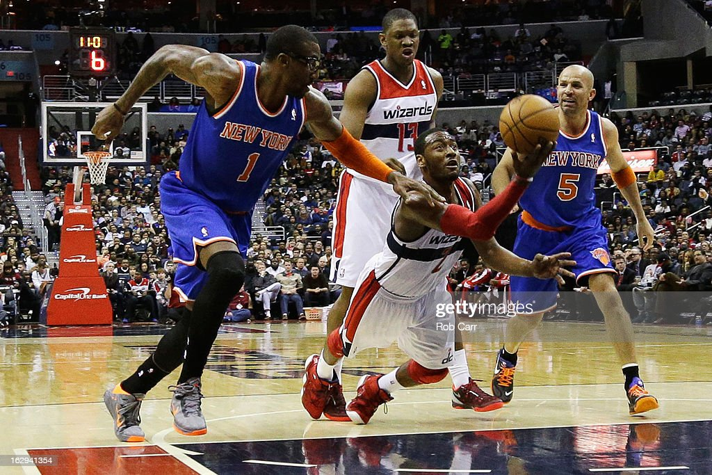 John Wall #2 of the Washington Wizards throws the ball up while being pressured by Amar'e Stoudemire #1 and Jason Kidd #5 of the New York Knicks during the second half of the Knicks 96-88 win at Verizon Center on March 1, 2013 in Washington, DC.