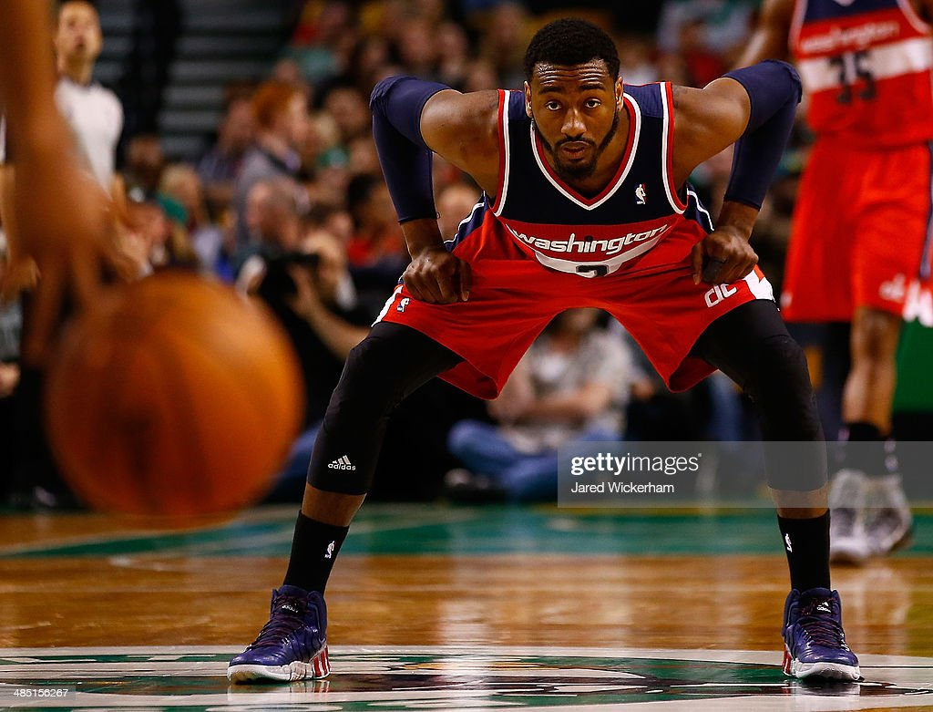 John Wall #2 of the Washington Wizards waits to defend against the Boston Celtics in the second half during the game at TD Garden on April 16, 2014 in Boston, Massachusetts.