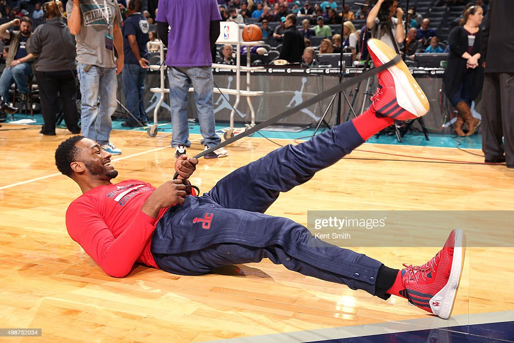 John Wall #2 of the Washington Wizards warms up before the game against the Charlotte Hornets on November 25, 2015 at Time Warner Cable Arena in Charlotte, North Carolina.