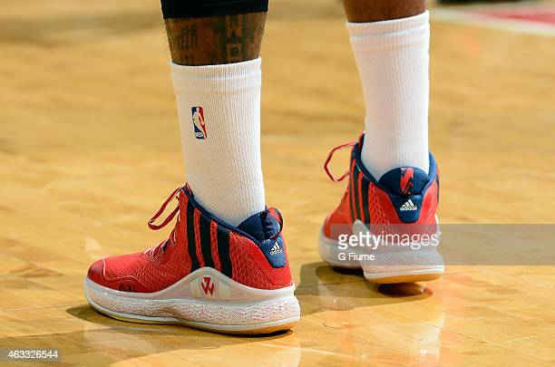 John Wall of the Washington Wizards wears Adidas shoes during the game against the Toronto Raptors at the Verizon Center on January 31 2015 in...