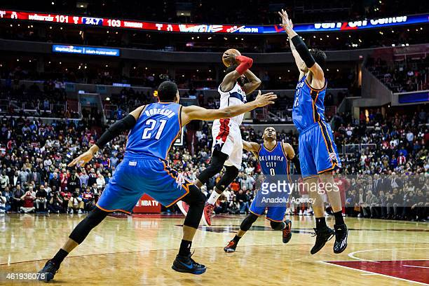 John Wall of Washington Wizard in action against Russell Westbrook Andre Roberson and Steven Adams of Oklahoma City Thunders during an NBA game at...