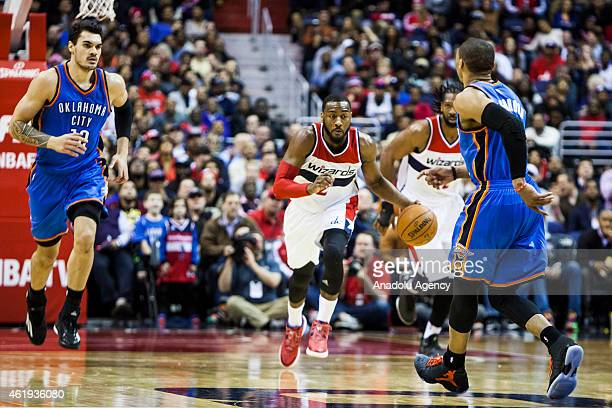 John Wall of Washington Wizard in action against Russell Westbrook and Steven Adams of Oklahoma City Thunder during an NBA game at the Verizon Center...