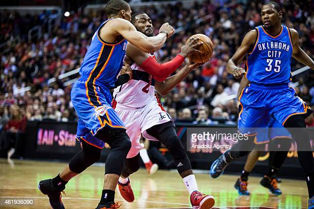 John Wall of Washington Wizard in action against Russell Westbrook and Kevin Durant of Oklahoma City Thunders during an NBA game at the Verizon...