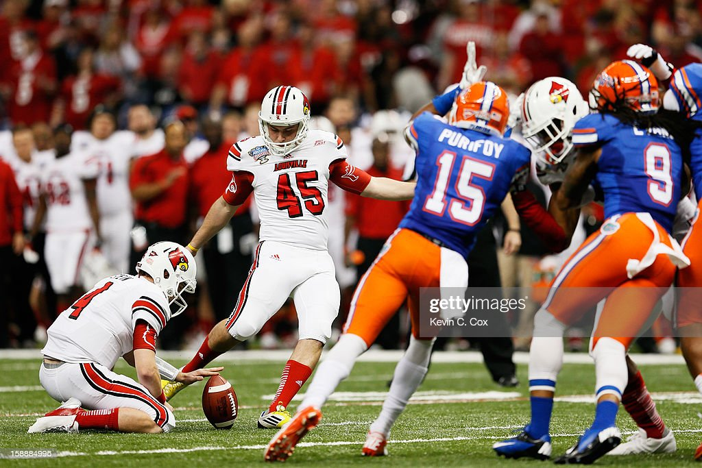 John Wallace #45 of the Louisville Cardinals kicks a second quarter field goal against the Florida Gators during the Allstate Sugar Bowl at Mercedes-Benz Superdome on January 2, 2013 in New Orleans, Louisiana.