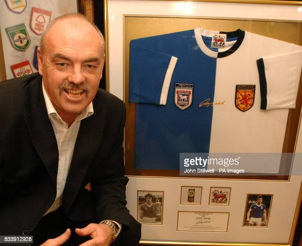 John Wark the former Ipswich Town and Scotland midfielder with a football shirt with both club and country joined together for charity at Harrods...